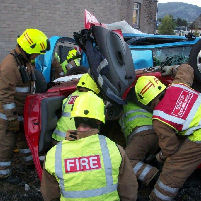 Woman rescued from overturned car