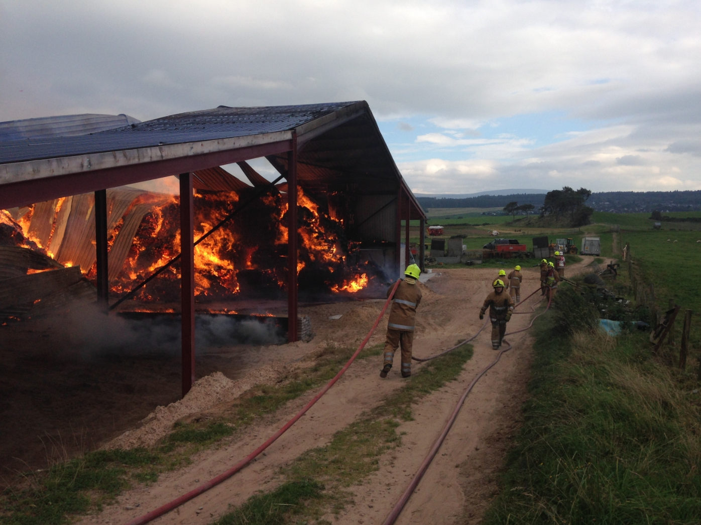 Crews remain at scene after large barn fire near Inverness