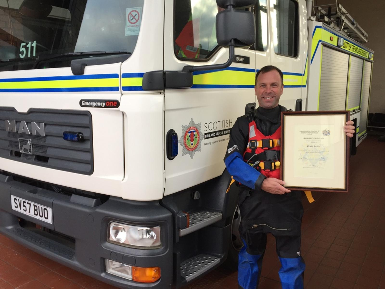 Firefighter given bravery award for saving woman from sinking car