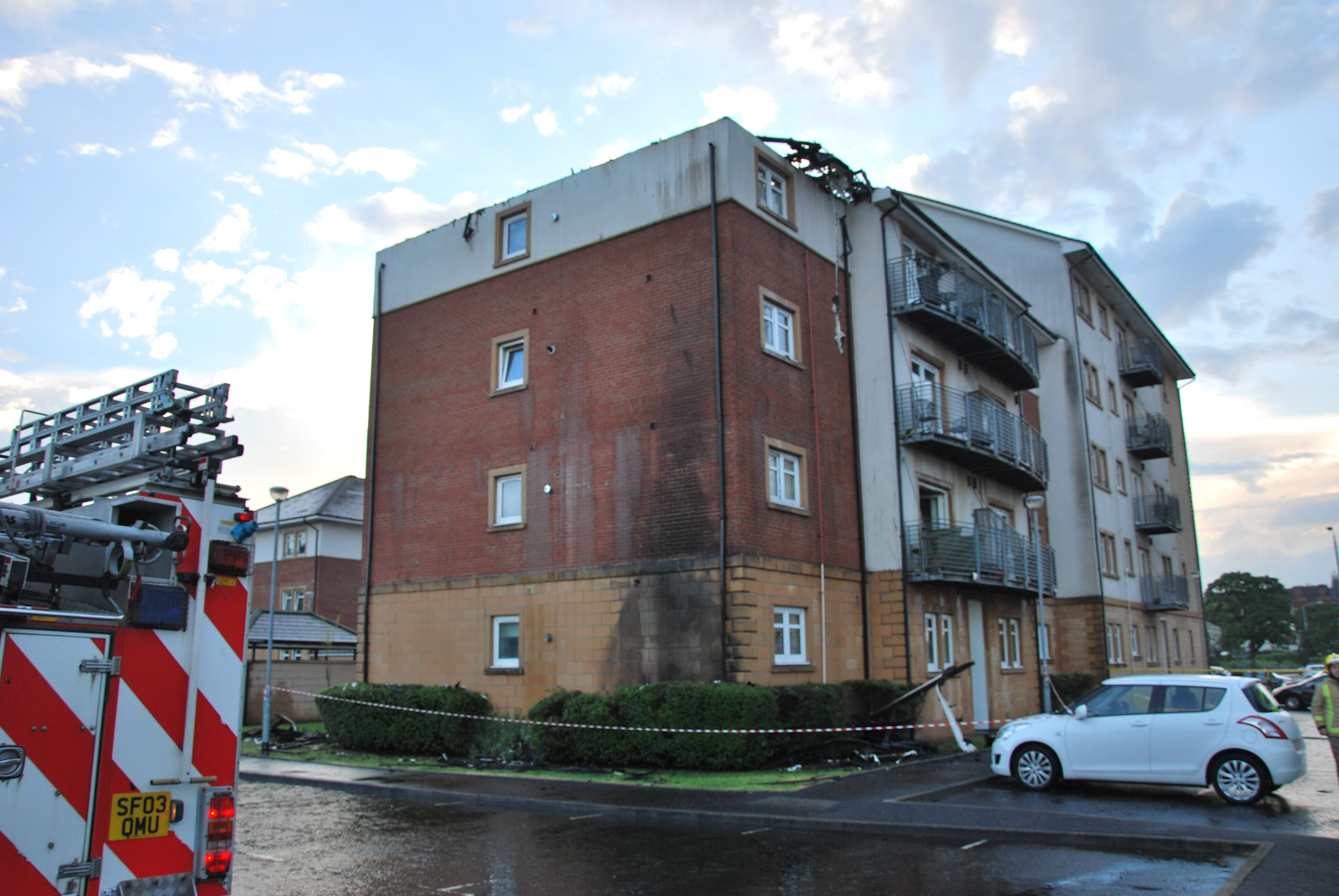 Crews tackle flat blaze following lightning strike in Greenock