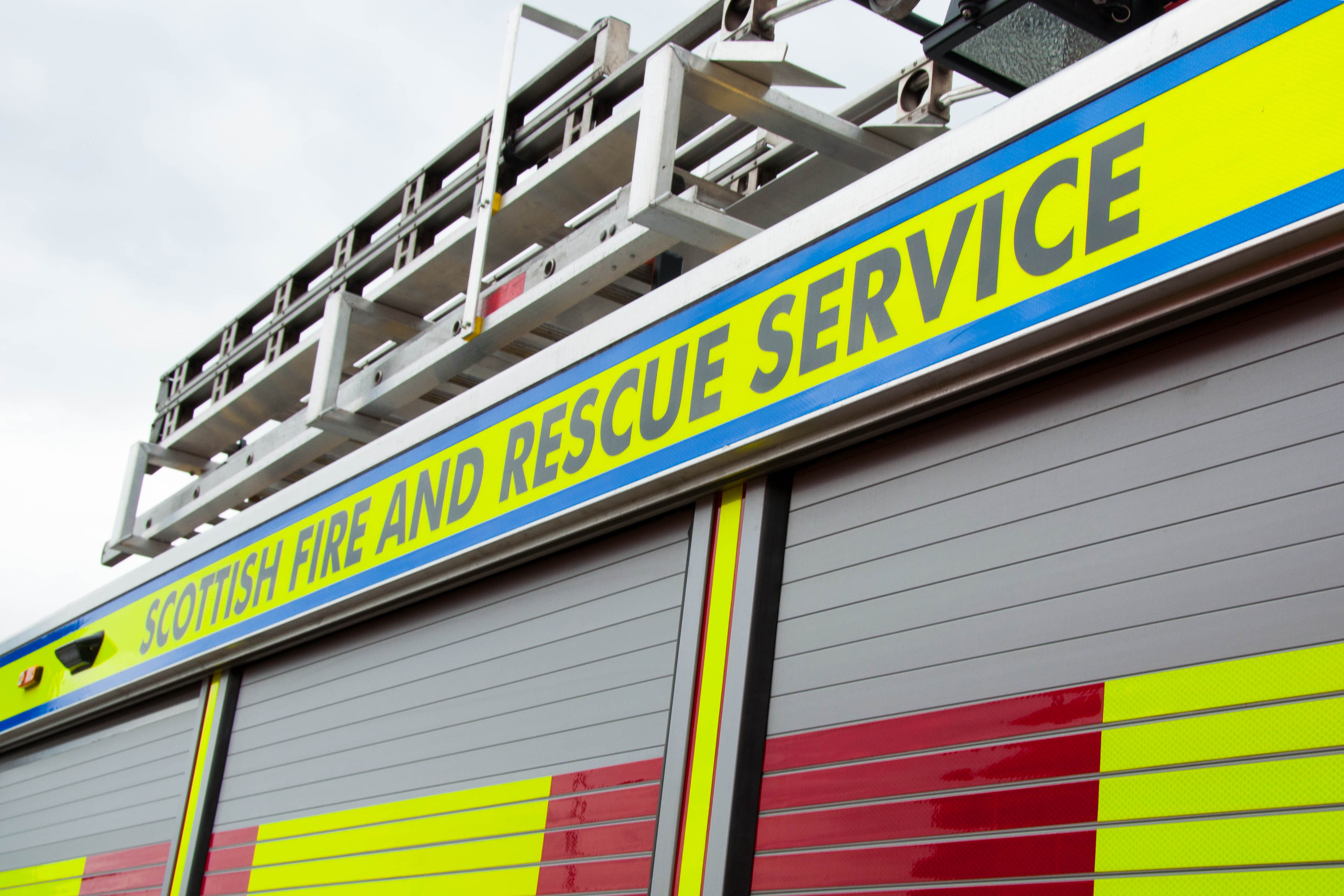 Firefighters use ladder to rescue a woman and boy from smoke-filled flat in Paisley