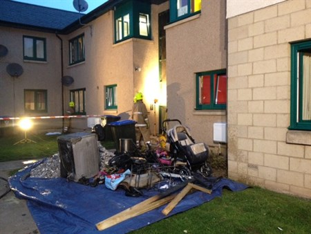 Combustible Materials Removed From Flat Fire