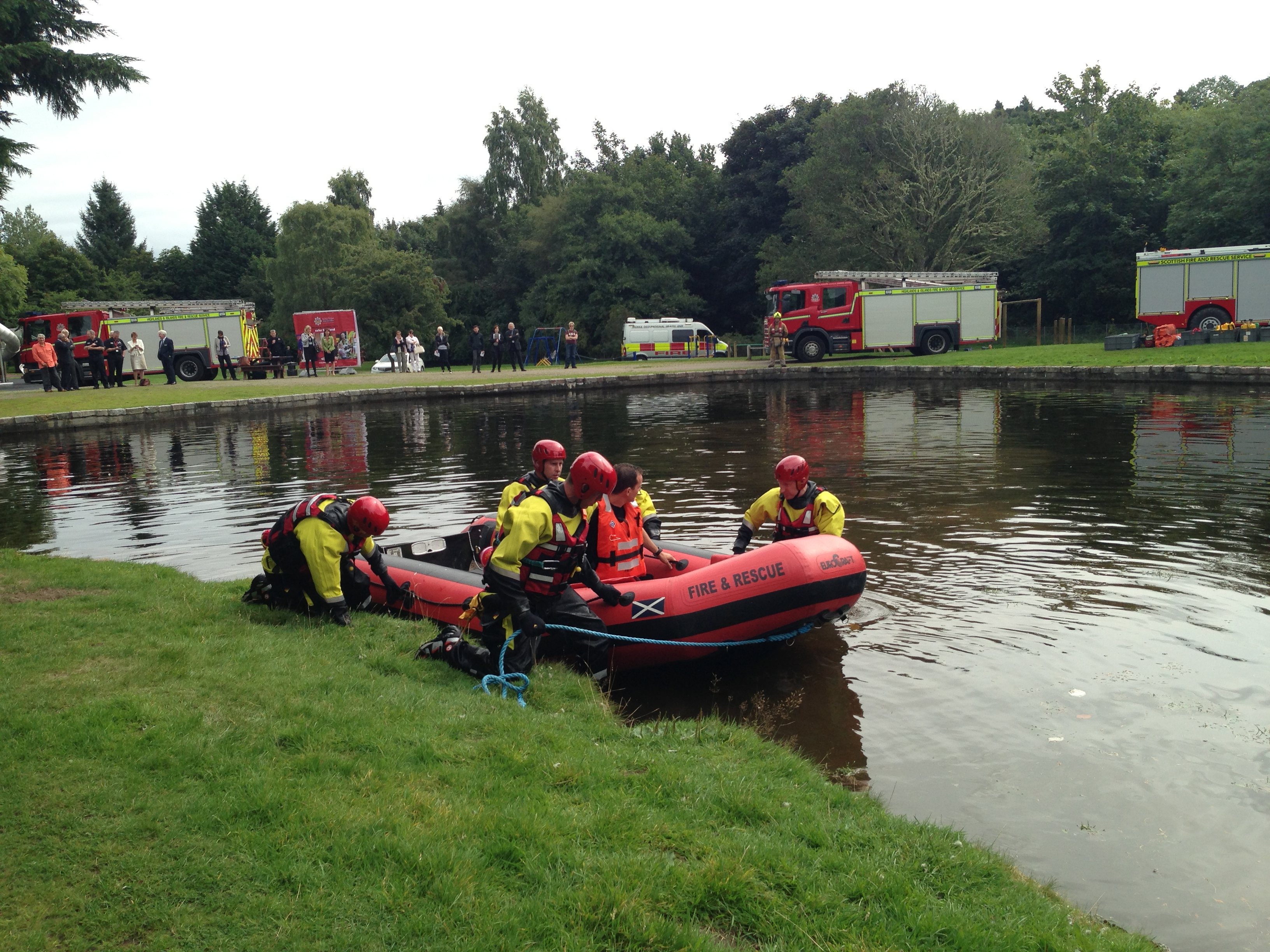 Firefighters help rescue people from flood water - Beauly