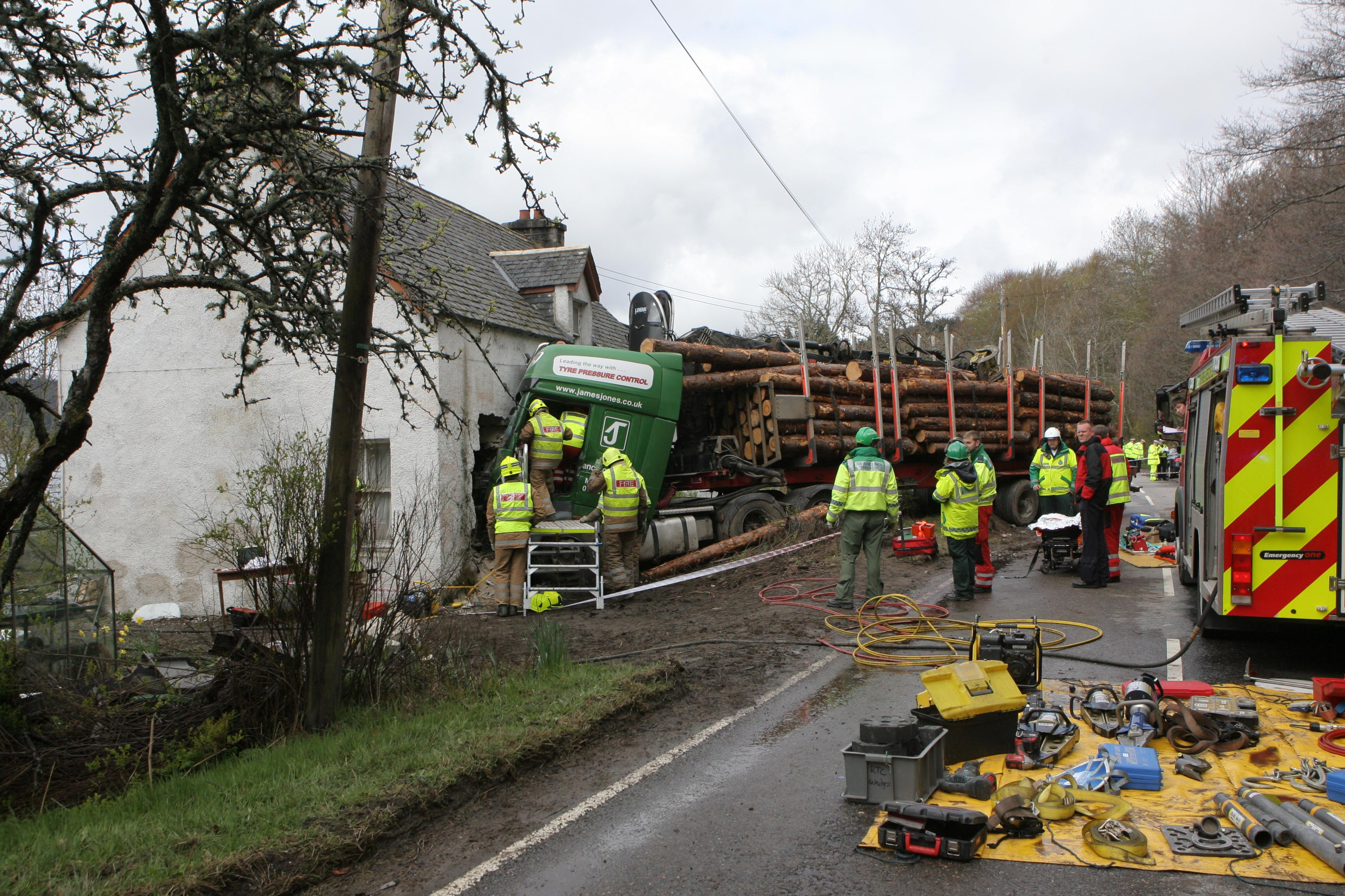 SFRS free man from HGV following collision with house on A831 (1)