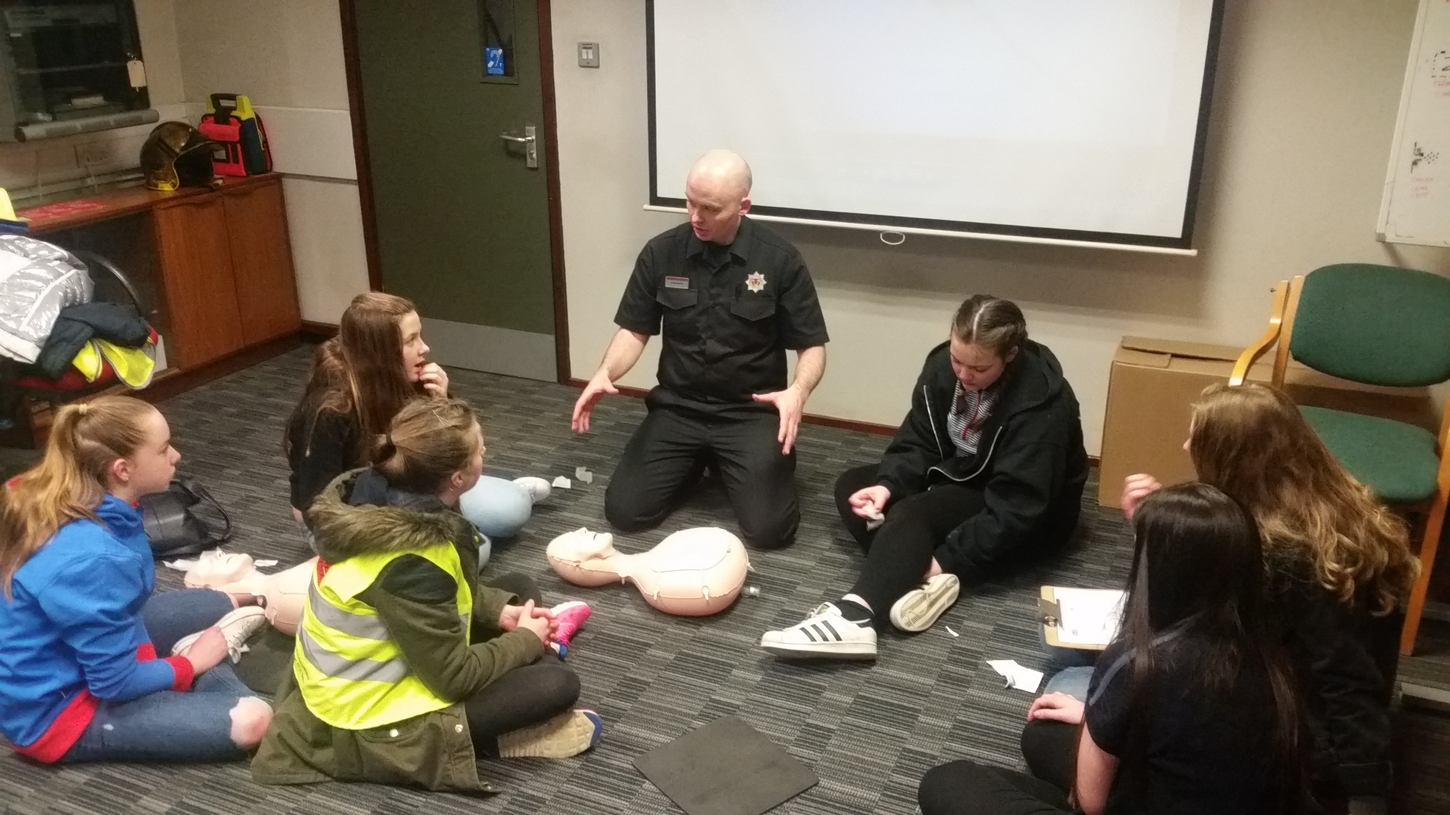 Firefighters teach CPR to girlguides