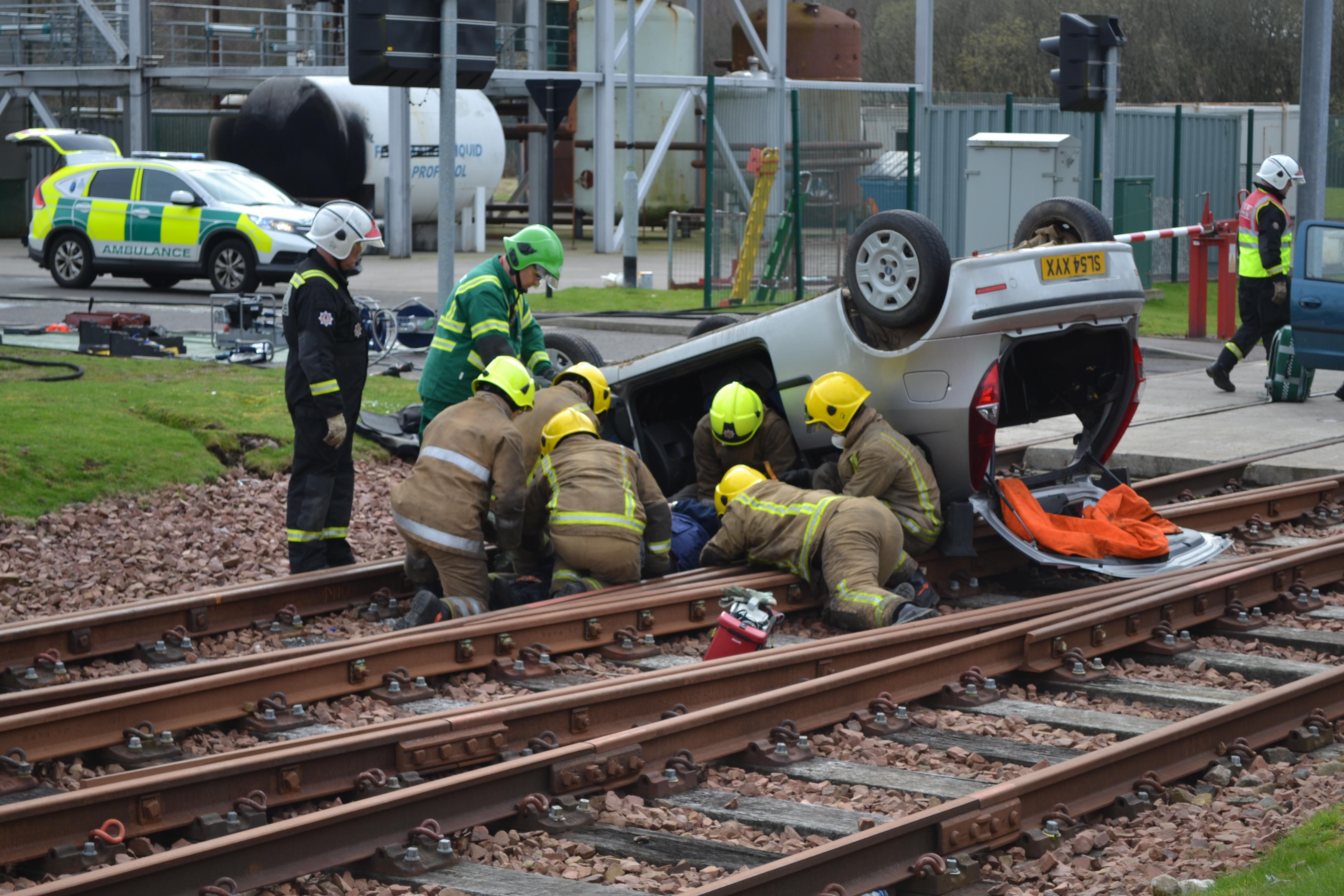 Trainee firefighters in disaster scenario exercise